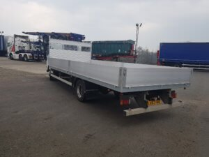 2013 Isuzu Forward N75.190 Dropside Conversion - rear left side view