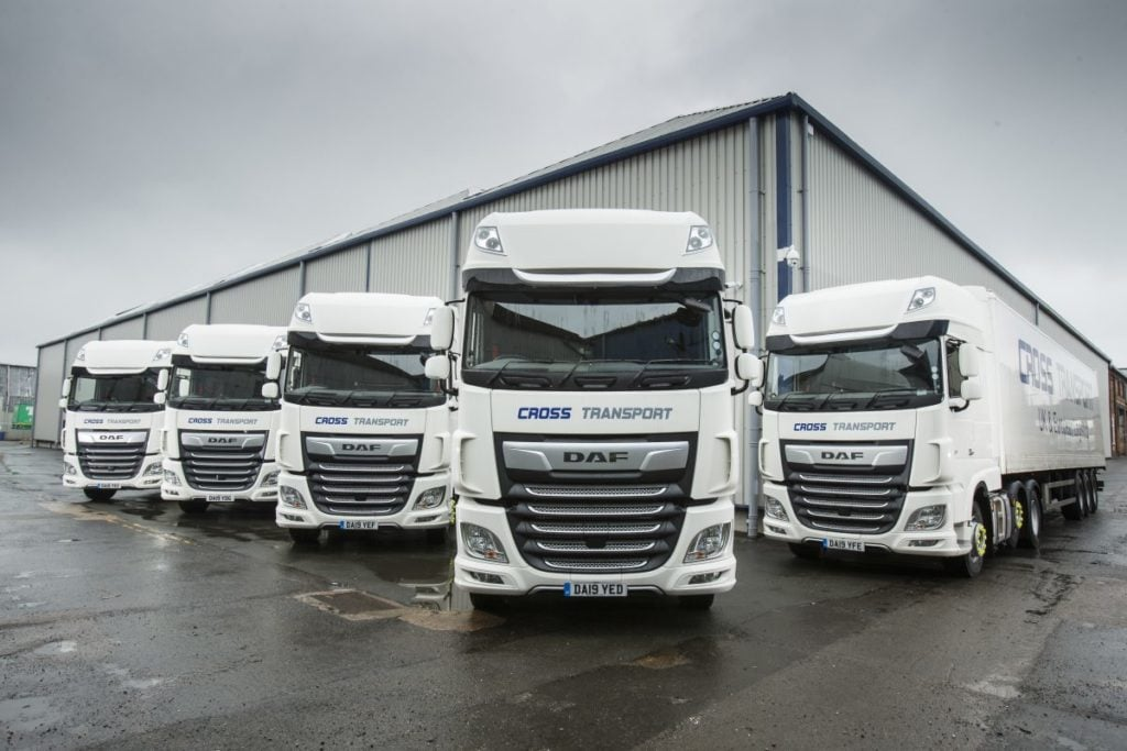 Asset Alliance Group has delivered a fleet of 56 new tractor units to Cross Transport, for operation on its contract with leading e-commerce business, Amazon.