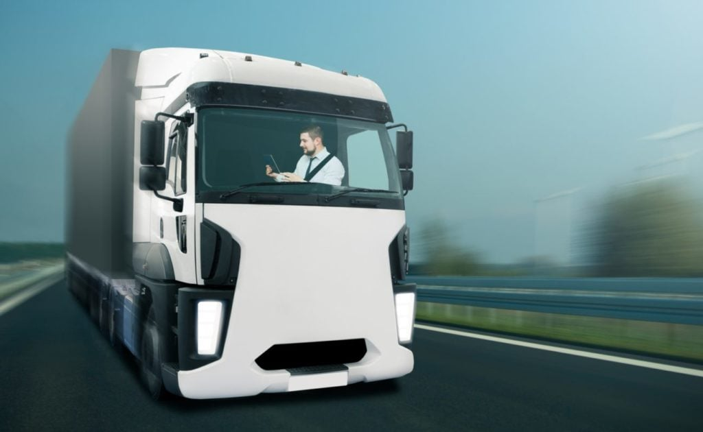 3d rendering of man controlling autonomous truck with tablet