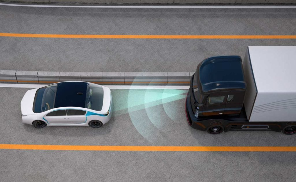 3d rendering of self-driving truck braking in front of motor car