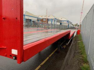 2012 SDC Stepframe Flat Trailer. 13.6m Tri-axle Flat, BPW Axles, Drum Brakes, Keruing Floor, Refurbished Body and Wheels in Red.