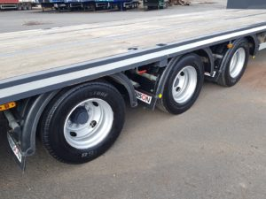 2016 Dennison Stepframe Flatbed Trailer. BPW Axles, Drum Brakes, Keruing Floor, 17.5 Inch Wheels, 4 x Twist Locks, 2 x Toolboxes, Raise Lower Valve Facility, 30ft Lower Bed with 2ft Extension at Rear, Neck is 15ft 8 including Front Extension.