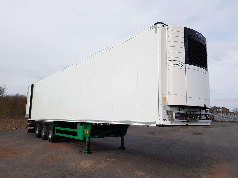 2015 Schmitz Single Temp Fridge Trailer. Carrier Vector 1550 Engine, 2.59m Internal Height, SAF Axles, Drum Brakes, Aluminium Floor, Barn Doors, 2 x Load Lock Rails, Raise Lower Valve Facility.