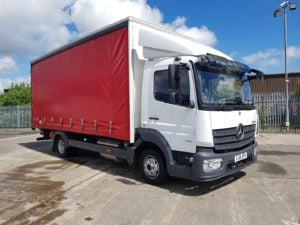 2018 Mercedes Atego Curtainside. 7.5 Tonne, 180bhp, Anteo Tuckaway Tailift (1000kg Capacity), 20ft Body, Day Cab, Euro 6, Automatic Gearbox, 45,521km, Steering Wheel Controls, Warranty Available.