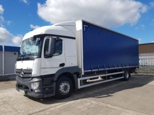 2018 Mercedes Actros Curtainsider. 18 Tonne, 240bhp, Euro 6, Automatic Gearbox, Streamspace Single Sleeper Cab, Anteo Tuckunder Tailift (1500kg Capacity), Barn Doors, Internal Straps, 28ft Body, Low Mileage, Choice & Warranty Available.